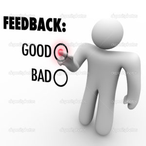 A man presses a button beside the word Good when giving feedback and opinions on a touch screen asking for positive or negative comments